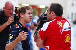 (L to R): Sebastian Vettel, Red Bull Racing talks with Stefano Domenicali, Ferrari General Director