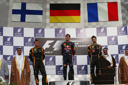 Podium: race winner Sebastian Vettel, Red Bull Racing, second place Kimi Raikkonen, Lotus F1 Team, third place Romain Grosjean, Lotus F1 Team