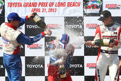 Victory circle: race winner Takuma Sato, A.J. Foyt Enterprises Honda, second place Graham Rahal, Rahal Letterman Lanigan Racing Honda, third place Justin Wilson, Dale Coyne Racing