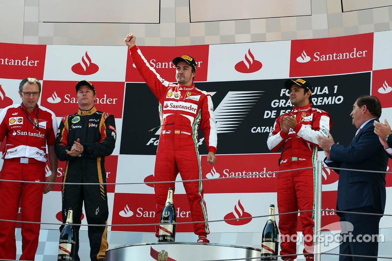 The podium, Lotus F1 Team, second; Fernando Alonso, Ferrari, race winner; Felipe Massa, Ferrari, third