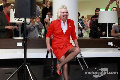 Branson serves as flight attendant on Air Asia