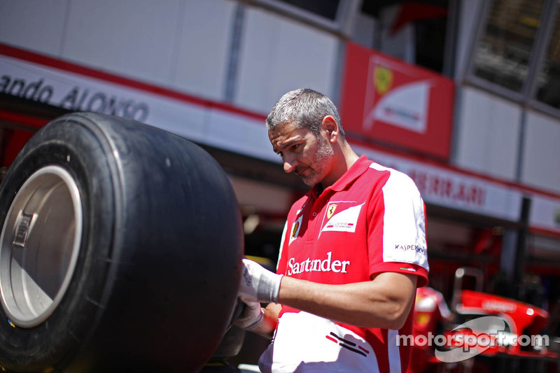 Ferrari mechanic with a Pirelli tyre