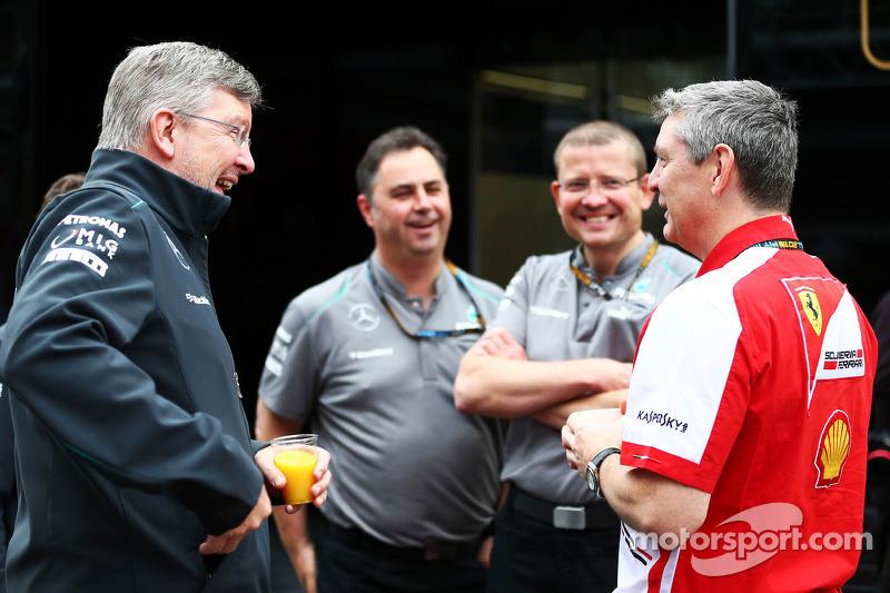 Ross Brawn, Mercedes AMG F1 Team Principal, with Steve Clark, Ferrari Chief Engineer