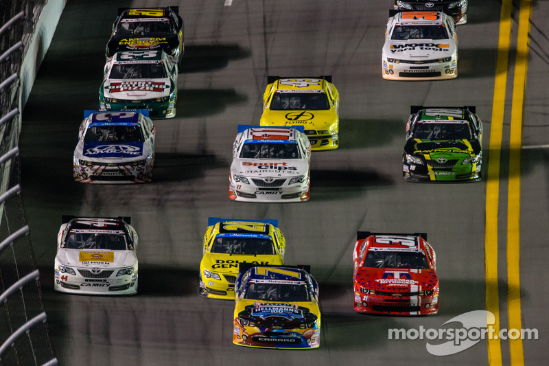 Regan Smith leads a group of cars