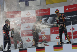 (L to R): race winner Sebastian Vettel, Red Bull Racing celebrates on the podium with Kimi Raikkonen