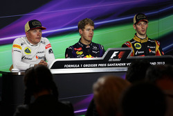 The FIA Press Conference: Kimi Raikkonen, Lotus F1 Team, second; Sebastian Vettel, Red Bull Racing, race winner; Romain Grosjean, Lotus F1 Team, third