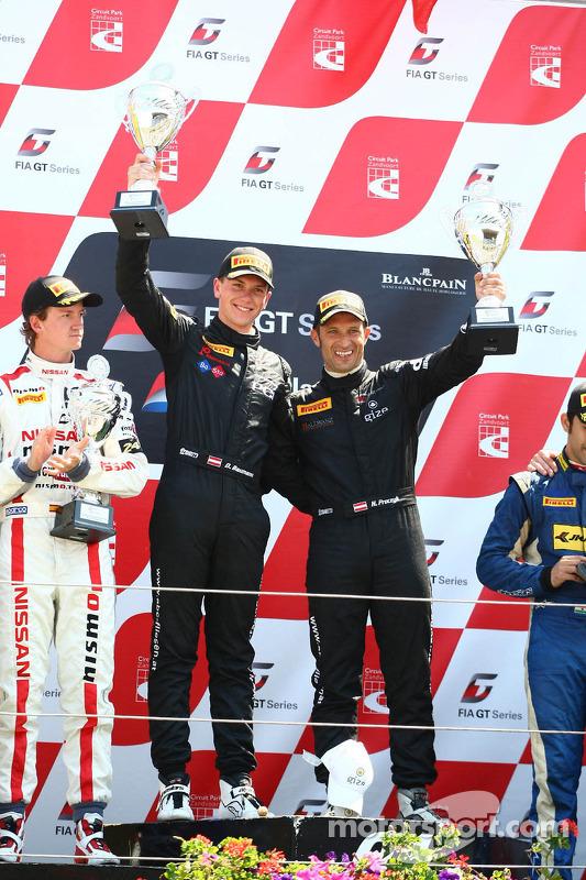 AM pódio: vencedores Hari Proczyk, Dominik Baumann, Lamborghini LP600+, Grasser Racing