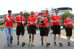 Max Chilton, Marussia F1 Team and Rodolfo Gonzalez, Marussia F1 Team Reserve Driver, walk the circuit