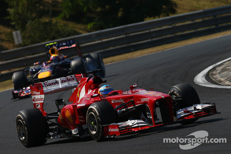 Fernando Alonso, Ferrari F138 leads Mark Webber, Red Bull Racing RB9