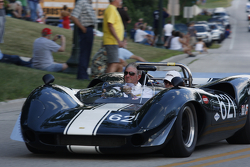 Race cars parade into Elkhart Lake for the Friday concours. #621 1965 Lola T-70: Tom Shelton
