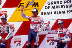 Podium: race winner Mick Doohan, second place Daryl Beattie, third place Alex Criville