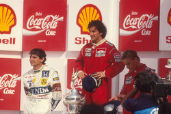 Podium: race winner Alain Prost, McLaren, second place Nelson Piquet, Williams, third place Stefan Johansson, McLaren