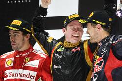 Podyum: 2. Fernando Alonso, Ferrari, Yarış galibi Kimi Raikkonen, Lotus F1 Team, 3. Sebastian Vettel, Red Bull Racing