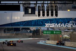 Max Verstappen, Red Bull Racing RB12, leads Nico Rosberg, Mercedes F1 W07 Hybrid, and Kimi Raikkonen, Ferrari SF16-H, as Daniil Kvyat, Toro Rosso STR11 Ferrari, parks up and retires