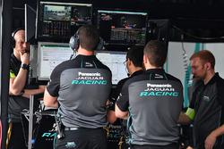 Jaguar Racing team members at work in the garage