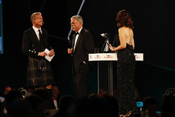 David Coulthard shares a joke with Chase Carey, Chairman, Formula One, Lee McKenzie