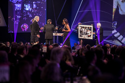 Nelson Piquet receives a lifetime achievement award from Gordon Murray, is presented with a Rainer Schlegelmilch print by Herbie Blash and daughter Julia Piquet