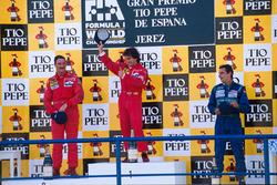 Podio: il vincitore della gara Alain Prost, il secondo classificato Nigel Mansell, il terzo classificato Alessadnro Nannini