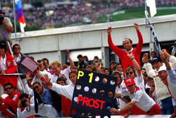 The McLaren team, including a delighted Jo Ramirez, celebrate victory for Alain Prost, McLaren