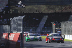 Roger Lago crosses the chequered flag
