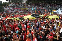 Fans celebrate under the podium