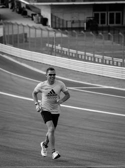 Tom Kristensen runs the track