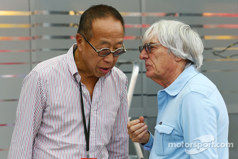 Bernie Ecclestone, CEO Formula One Group, with Ong Beng Seng, Owner Hotel Properties Ltd and Singapo