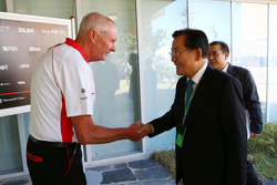John Booth, Marussia F1 Team Team Principal with Park Joon-Young, Head of the F1 Organising Committee of South Jeolla Province
