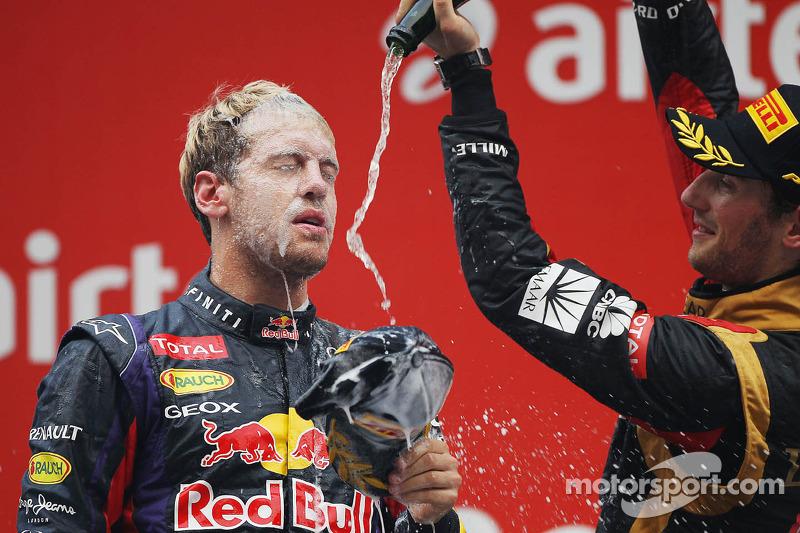 Race winner and World Champion Sebastian Vettel, Red Bull Racing celebrates on the podium with third