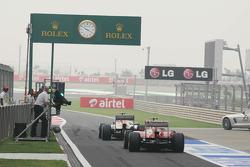 Paul di Resta, Sahara Force India VJM06 leads Fernando Alonso, Ferrari F138 out of the pits