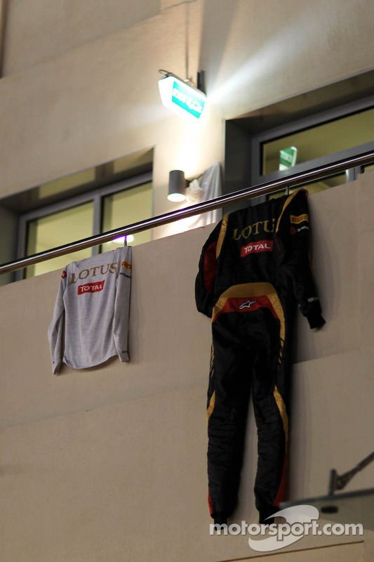 The race overalls of Romain Grosjean, Lotus F1 Team hanging from a balcony to dry