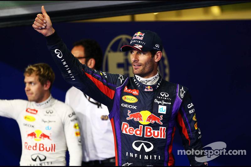 Mark Webber, Red Bull Racing celebrates his pole position in parc ferme with team mate Sebastian Vettel, Red Bull Racing