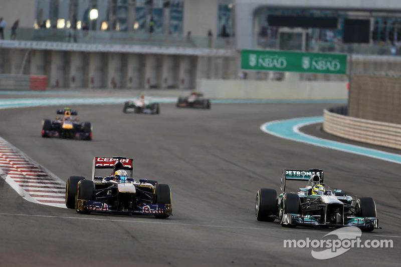 Jean-Eric Vergne, Scuderia Toro Rosso  and Nico Rosberg, Mercedes GP