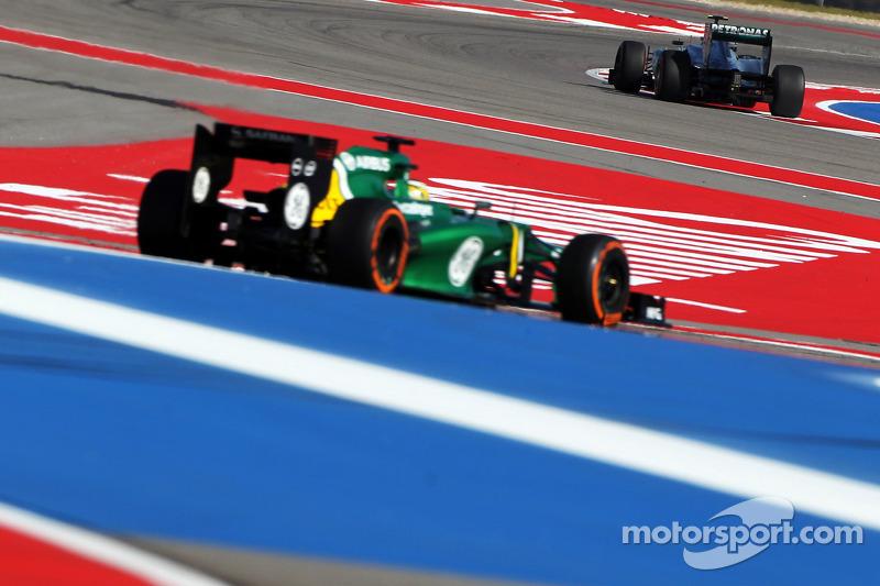 Lewis Hamilton, Mercedes AMG F1 W04 leads Charles Pic, Caterham CT03