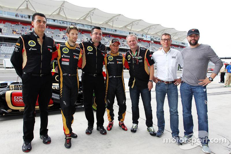 (L to R): Romain Grosjean, Lotus F1 Team with Eric Boullier, Lotus F1 Team Principal; Heikki Kovalai