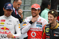 (Da esquerda para direita): Mark Webber, Red Bull Racing; Jenson Button, McLaren; e Romain Grosjean, Lotus F1 Team, no desfile dos pilotos