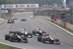 Sergio Perez, McLaren MP4-28 and Heikki Kovalainen, Lotus F1 E21 battle for position