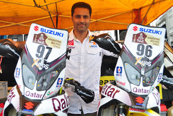 Nasser Al-Attiyah with his bike team