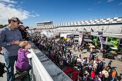Fans watch the garage activity