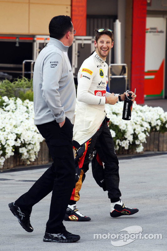 (L to R): Eric Boullier, McLaren Racing Director with Romain Grosjean, Lotus F1 Team