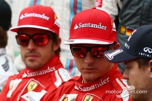 (L to R): Fernando Alonso, Ferrari with Kimi Raikkonen, Ferrari and Sebastian Vettel, Red Bull Racing at the drivers start of season photograph