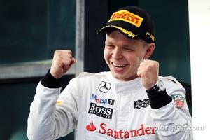 Kevin Magnussen, McLaren celebrates his third position on the podium