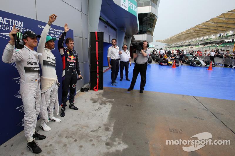 Pole position Lewis Hamilton, segundo lugar Sebastian Vettel, terceiro lugar Nico Rosberg