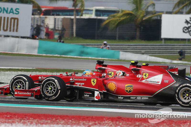 (L to R): Fernando Alonso, Ferrari F14-T and team mate Kimi Raikkonen, Ferrari F14-T at the start of