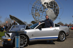 Gary Welch stands beside his 2008 Ford Mustang GT500 KR at the Mustang's 50th birthday celebration in New York
