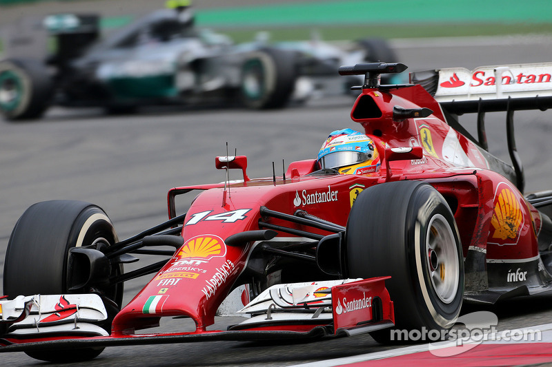 Fernando Alonso, Scuderia Ferrari and Nico Rosberg, Mercedes AMG F1 Team