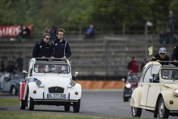 The drivers parade in Citroën 2CV