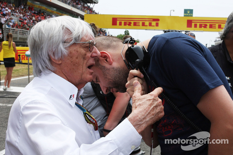 (L to R): Bernie Ecclestone, with Gerard Lopez, Lotus F1 Team Principal on the grid