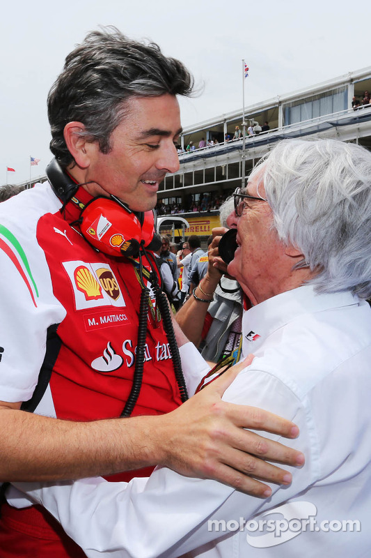 (L to R): Marco Mattiacci, Ferrari Team Principal with Bernie Ecclestone, on the grid