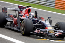Sebastian Vettel, Scuderia Toro Rosso STR03 crosses the line to win his first GP